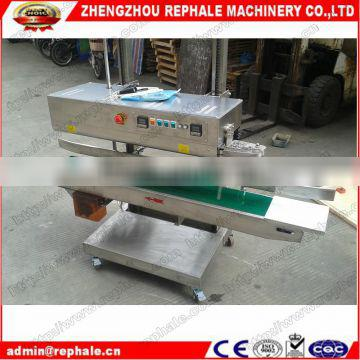 Vertical band sealing machine with easy operation