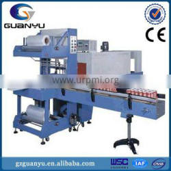 Automatic over wrapping heat shrinking machine