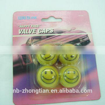 New style tire valve caps with Happy Face design