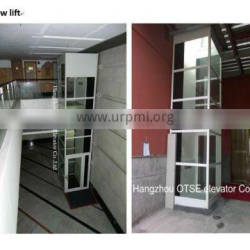 Hydraulic wheelchair lift for the disabled