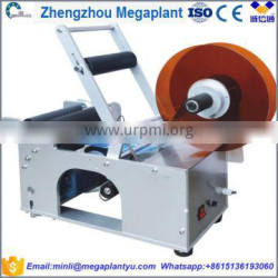 Manual hot melt wet glue water bottles labeling and coding machine