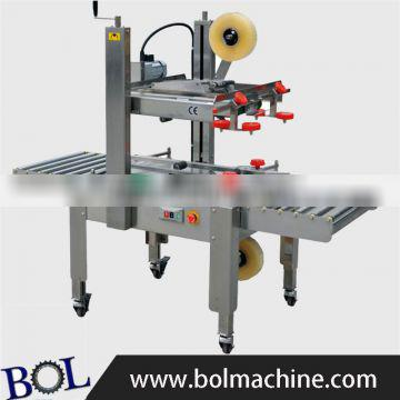 FXJ6050S Automatic carton top and bottom driven sealing machine taping sealer