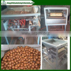 Automatic nuts processing/cracking machine in Vietnamese